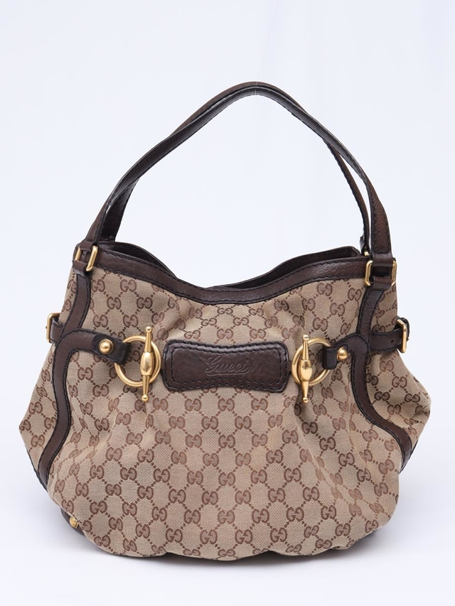 Bolsa Gucci GG Canvas Horsebit Jockey Medium