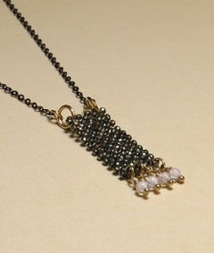 Trama (Thread) Necklace with faced hematite, moonstone, black rhodium chain and golden elements